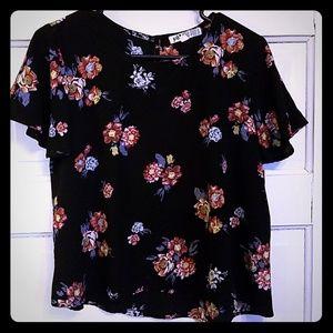 Short sleeved floral pattern blouse never worn